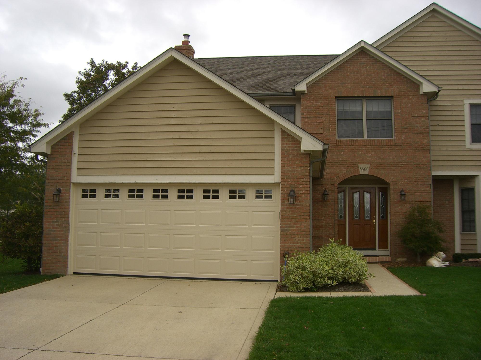 Raised panel garage doors st cloud mn american door works for Insulated garage doors
