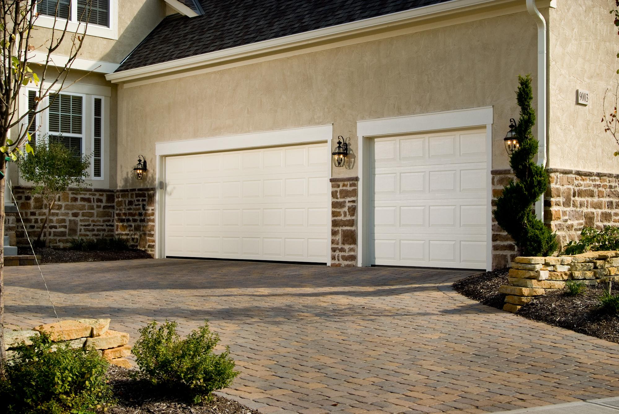 Raised panel garage doors st cloud mn american door works for Three door garage