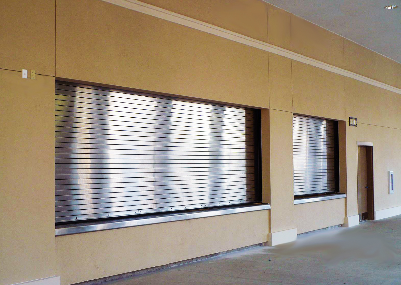 Rolling steel door on building - Service Doors Are Metal Slatted Rolling Doors Used To Provide Security Against Entry Or Weather Protection At Exterior And Interior Openings In Industrial