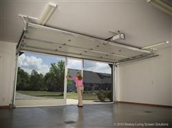 Retractable roll up garage door screens st cloud mn adw for Roll down garage door screen